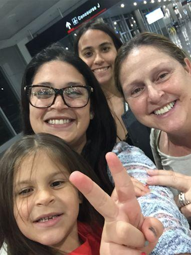 Deborah DrahusCapo (right) with (from bottom) her granddaughter, daughter and niece at the airport in San Juan, Puerto Rico.
