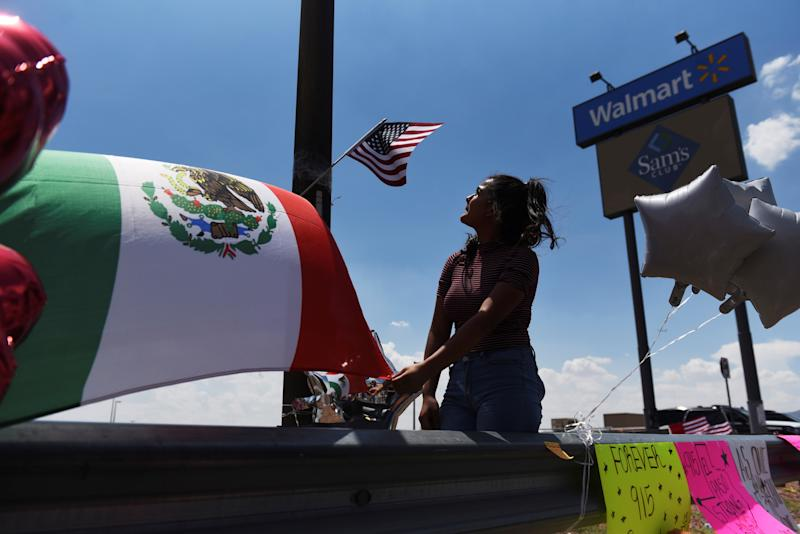 People gather to pay their respects at a growing memorial site two days after a mass shooting at a Walmart store in El Paso, Texas, U.S. August 5, 2019. REUTERS/Callaghan O'Hare