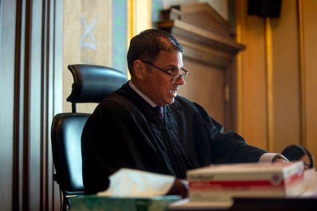 Genesee County Circuit Judge Mark Latchana on Monday ordered the money distributed by Shiawassee County commissioners to be frozen pending further review. (Photo: via Associated Press)