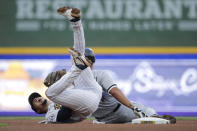 Milwaukee Brewers' Willy Adames, left, reacts after tagging out Chicago White Sox's Jose Abreu at second base during the fourth inning of a baseball game Saturday, July 24, 2021, in Milwaukee. (AP Photo/Aaron Gash)