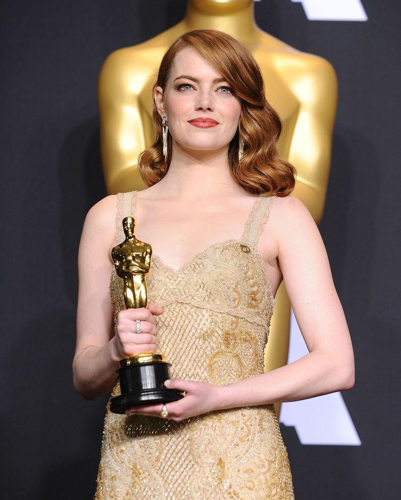 <p>Best actress winner Emma Stone gave her Planned Parenthood accessory the spotlight, pinning it at the top of her dress. (Photo: Getty Images) </p>