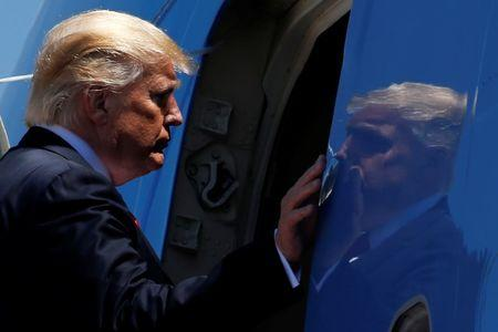 U.S. President Donald Trump boards Air Force One for travel to Atlanta from Joint Base Andrews