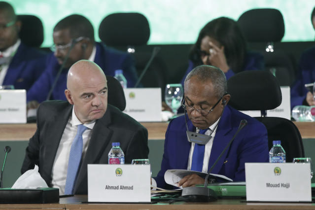 Confederation of African Football president Ahmad Ahmad of Madagascar, right, and FIFA president Gianni Infantino attend the Confederation of African Football general assembly in Cairo, Egypt, Thursday, July 18, 2019. The African soccer body is holding its first major meeting since announcing that FIFA will send a senior official to lead a clean-up of the scandal-plagued organization in an unprecedented move for soccer. The Confederation of African Football, whose president is facing numerous allegations of corruption amid the crisis, is holding its general assembly on Thursday in Cairo on the eve of the African Cup final. (AP Photo/Hassan Ammar)