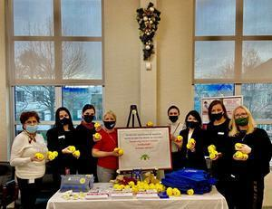 New York's PSFCU McGuinness Branch employees seeking donations during Children's Holiday Smile charity drive in December 2020.