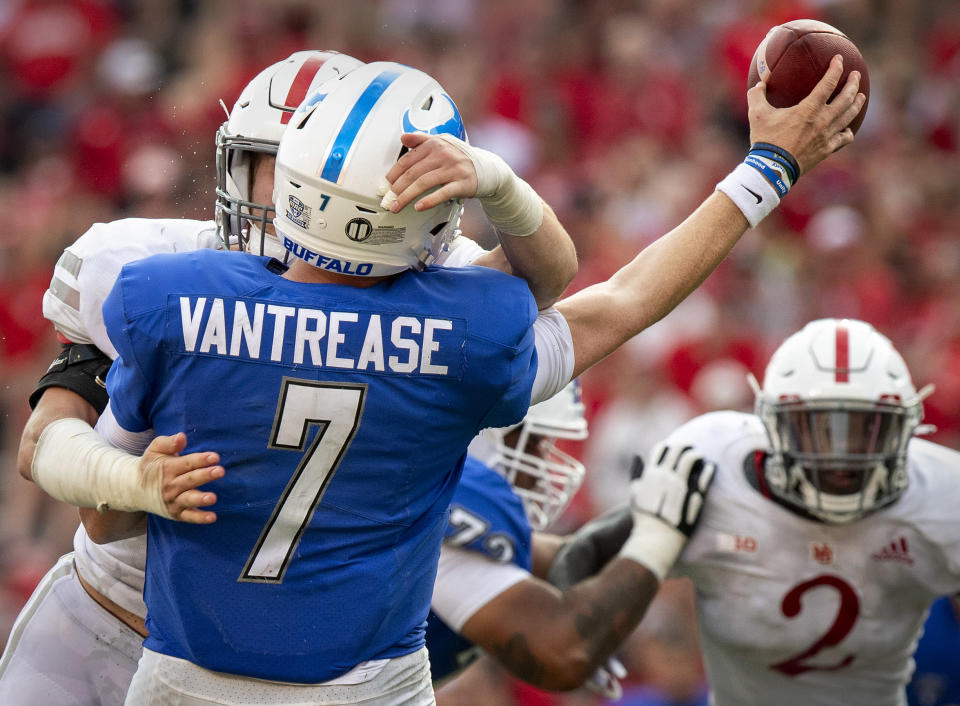 Buffalo quarterback Kyle Vantrease (7) is hit by Nebraska linebacker Nick Henrich as he releases the ball in the fourth quarter of an NCAA college football game Saturday, Sept. 11, 2021, in Lincoln, Neb. (Francis Gardler/Lincoln Journal Star via AP)