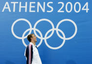 FILE - In this Aug. 14, 2004, file photo, Michael Phelps, of the United States, smiles after his win in the 400-meter individual medley at the Olympic Games in Athens, Greece. For the first time since 1996, the U.S. Olympic swimming trials are being held without the sport's biggest star, the guy who won a staggering 23 gold medals and 28 medals overall at the Olympics. (AP Photo/Mark Baker, File)