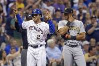 Milwaukee Brewers' Trent Grisham (2) gestures after hitting a three-run triple during the seventh inning of the team's baseball game against the Pittsburgh Pirates on Friday, Sept. 20, 2019, in Milwaukee. (AP Photo/Aaron Gash)