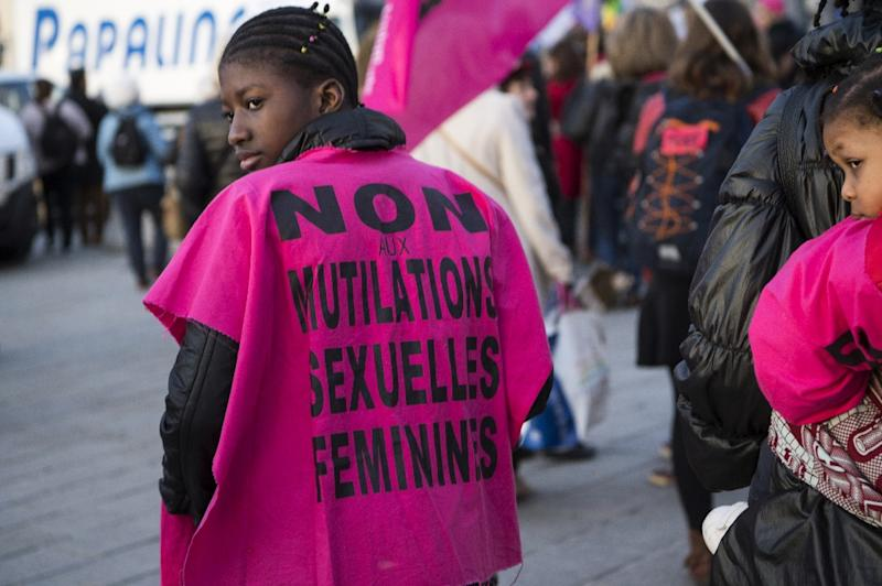 "A woman wears a jersey reading, ""No to female genital mutilation"" during a demonstration in 2018"