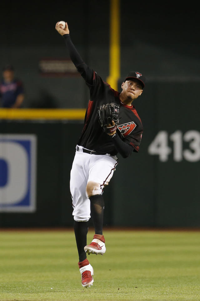 Arizona Diamondbacks third baseman Wilmer Flores makes an off-balance throw to get the out on a ball hit by Arizona Diamondbacks'David Peralta in the sixth inning during a baseball game, Saturday, April 6, 2019, in Phoenix. (AP Photo/Rick Scuteri)
