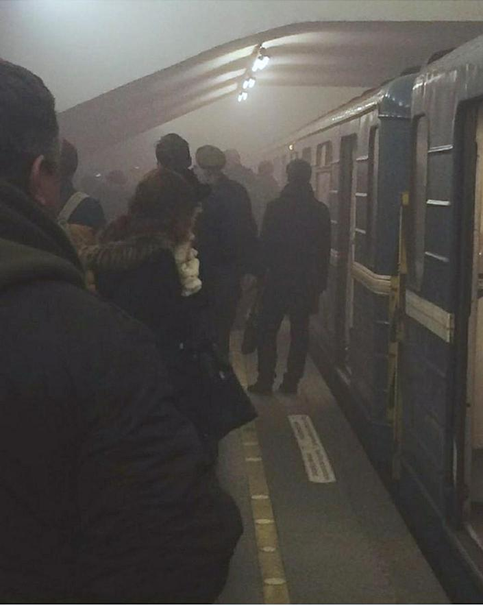 <p>People stand on the platform at Sennaya Square metro station in St. Petersburg, Russia, April 3, 2017. At least 10 people were killed Monday in an explosion on the subway in St. Petersburg, Russian news agencies reported. (Russian Look via ZUMA Wire) </p>
