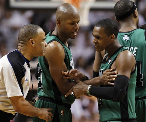 Boston Celtics' Ray Allen, center, restrains Rajon Rondo as Rondo complains to official Dan Crawford, during the first half of Game 1 in their NBA basketball Eastern Conference finals playoffs series, against the Miami Heat Monday May, 28, 2012, in Miami. (AP Photo/Lynne Sladky)
