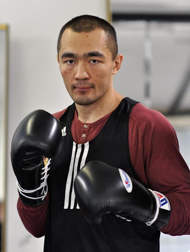 In this photo taken April 5, 2014, WBA and IBA light heavyweight boxing champion Beibut Shumenov, of Kazakhstan, poses in Las Vegas. Shumenov and IBF light heavyweight champion Bernard King will fight at the DC Armory on Saturday, April 19. (AP Photo/Joe Coomber)