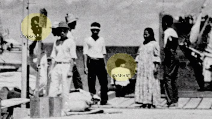 The yellow circles show the individuals that may be Amelia Earhart and Fred Noonan. <cite>National Archives</cite>