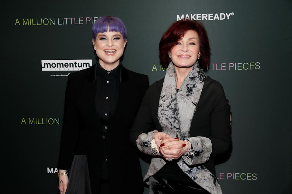 """Kelly Osbourne (L) and Sharon Osbourne (R) pose at the LA Special Screening of the film """"A Million Little Pieces,"""" in West Hollywood, California, U.S., December 4, 2019. REUTERS/Danny Moloshok"""