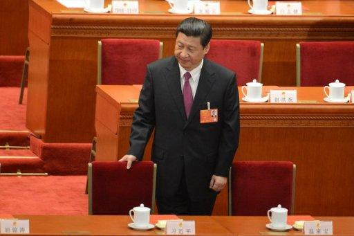 "<p>Newly-elected China's President, Xi Jinping, takes his seat at the closing session of the National People's Congress (NPC), at the Great Hall of the People in Beijing, on March 17, 2013. Xi said he would fight for a ""great renaissance of the Chinese nation"", in his first speech as head of state of the world's most populous country, without giving a detailed account of the phrase's meaning.</p>"