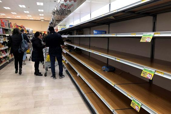 Empty shelves at a Milan supermarket as people stockpile due to the fear of the new coronavirus (EPA)