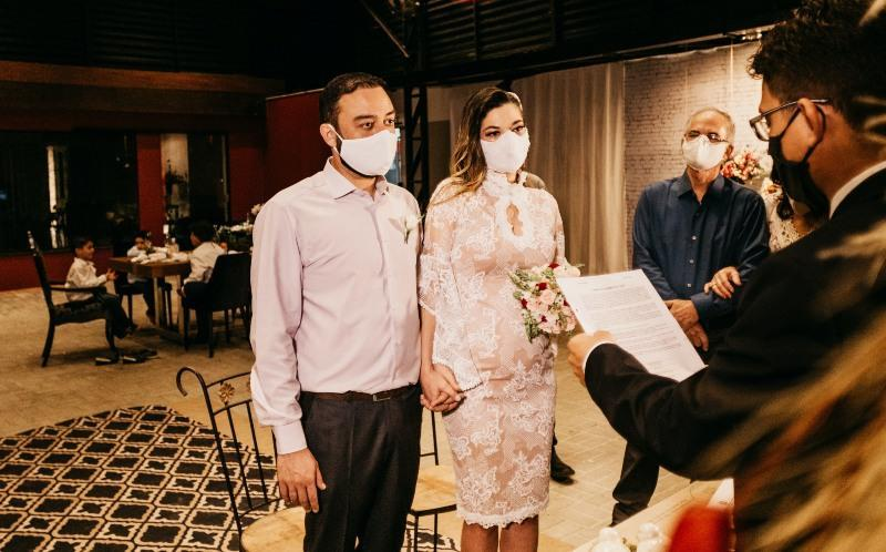 File photo of a wedding ceremony in which the attendees are wearing face masks. Photo: Jonathan Borba/Unsplash