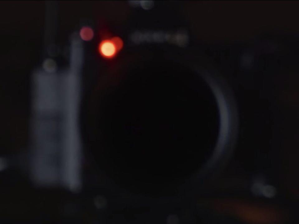 """An out of focus camera reflecting in a mirror during Bo Burnham's """"Inside"""" special."""