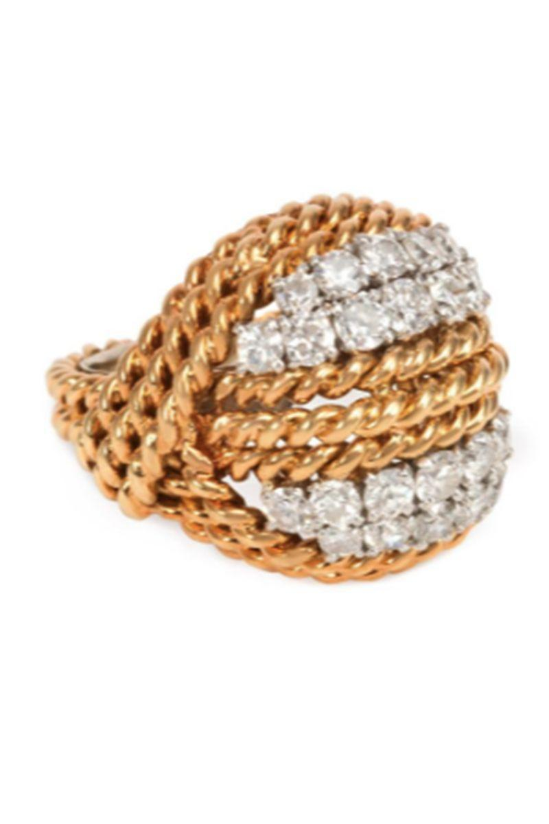 "<p><strong>Kenshire</strong> <em>Mid-century gold and diamond turban ring, circa 1955, $10,750, <a href=""https://www.kentshire.com/collections/fine-jewelry/products/gold-and-diamond-turban-ring"" rel=""nofollow noopener"" target=""_blank"" data-ylk=""slk:kentshire.com"" class=""link rapid-noclick-resp"">kentshire.com</a><br></em></p><p><em><a class=""link rapid-noclick-resp"" href=""https://www.kentshire.com/collections/fine-jewelry/products/gold-and-diamond-turban-ring"" rel=""nofollow noopener"" target=""_blank"" data-ylk=""slk:SHOP"">SHOP</a></em></p>"