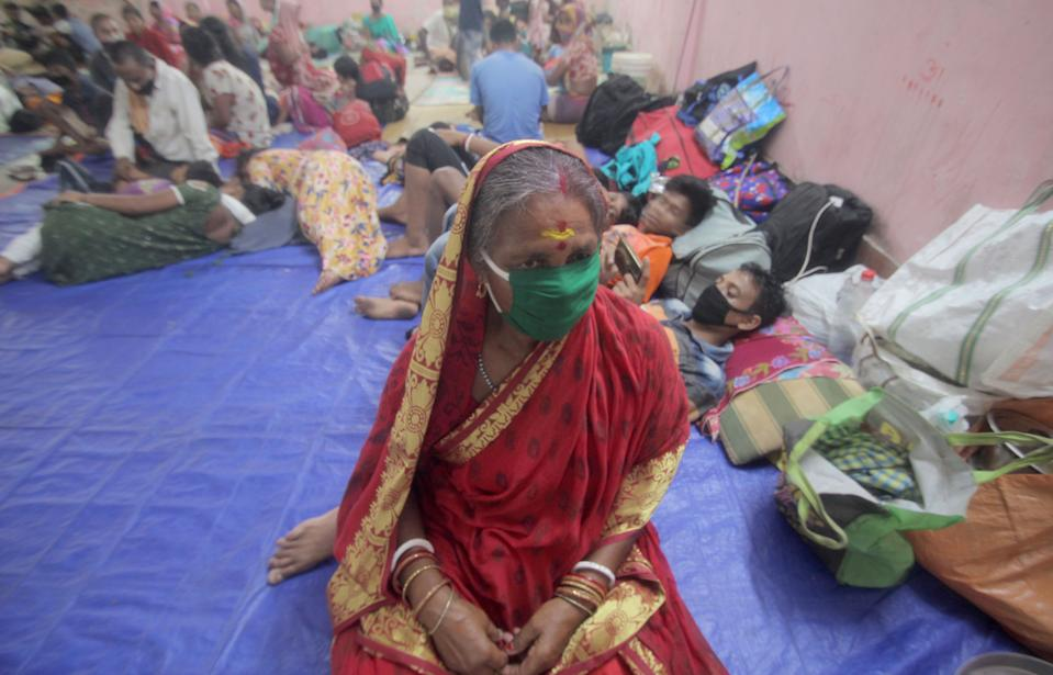 Residents rest in a shelter ahead of the expected landfall of cyclone Amphan in Dhamra area of Bhadrak district, 160 km away from the eastern Indian state Odisha's capital city as the Cyclone 'Amphan' cross the Bay of Bengal Sea's eastern coast making devastation on the cyclonic weather wind and rain and make landfall on the boarder of West Bengal and Bangladesh on May 20, 2020. (Photo by STR/NurPhoto via Getty Images)