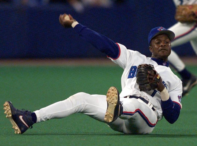 FILE - In this Sept. 17, 1999, file photo, Toronto Blue Jays third baseman Tony Fernandez throws to first as he tumbles to the turf during third-inning AL action against the Chicago White Sox in Toronto. Former All-Star shortstop Fernandez remained on a life support system Sunday, Feb. 16, 2020, pending a decision by his family on how to proceed, the director of his foundation said. He had been in a medically induced coma, said Imrad Hallim, the director and co-founder of the Tony Fernndez Foundation. Fernandez was ill with a kidney disease for years and waiting for a transplant. (Frank Gunn/The Canadian Press via AP, File)