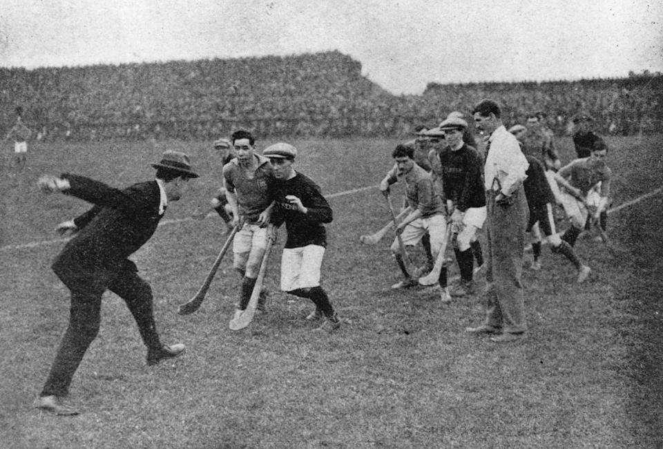 Sinn Fein leader and Commander-In-Chief of the Irish Free State Army Michael Collins starting a hurling match at Croke Park in 1921Getty Images