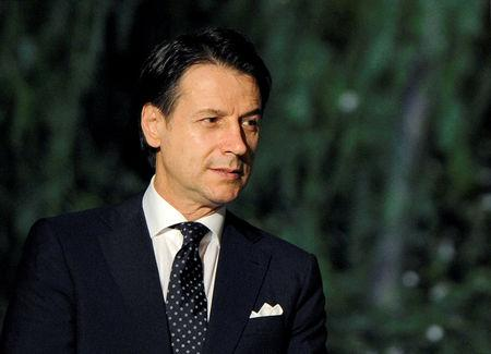 FILE PHOTO: Italy's Prime Minister Giuseppe Conte awaits to welcome participants as they arrive to attend the first day of the international conference on Libya in Palermo