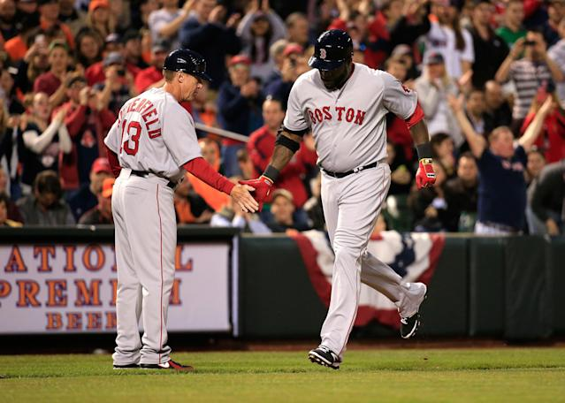 BALTIMORE, MD - APRIL 02: Third base coach Brian Butterfield #13 congratulates David Ortiz #34 after hitting a two RBI home run against the Baltimore Orioles in the third inning at Oriole Park at Camden Yards on April 2, 2014 in Baltimore, Maryland. (Photo by Rob Carr/Getty Images)