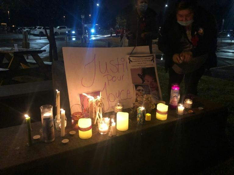 People hold a candlelight vigil in memory of Joyce Echaquan on September 29, 2020, near Joliette Hospital, near Montreal, Quebec