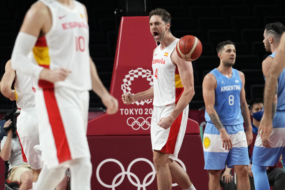 Spain's Pau Gasol (4) celebrates after making a basket during a men's basketball preliminary round game against Argentina at the 2020 Summer Olympics, Thursday, July 29, 2021, in Saitama, Japan. (AP Photo/Eric Gay)