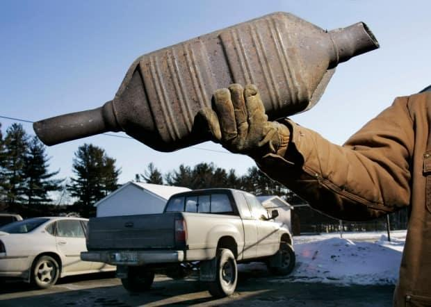 An example of a catalytic converter. Thieves typically crawl under vehicles to cut them out.