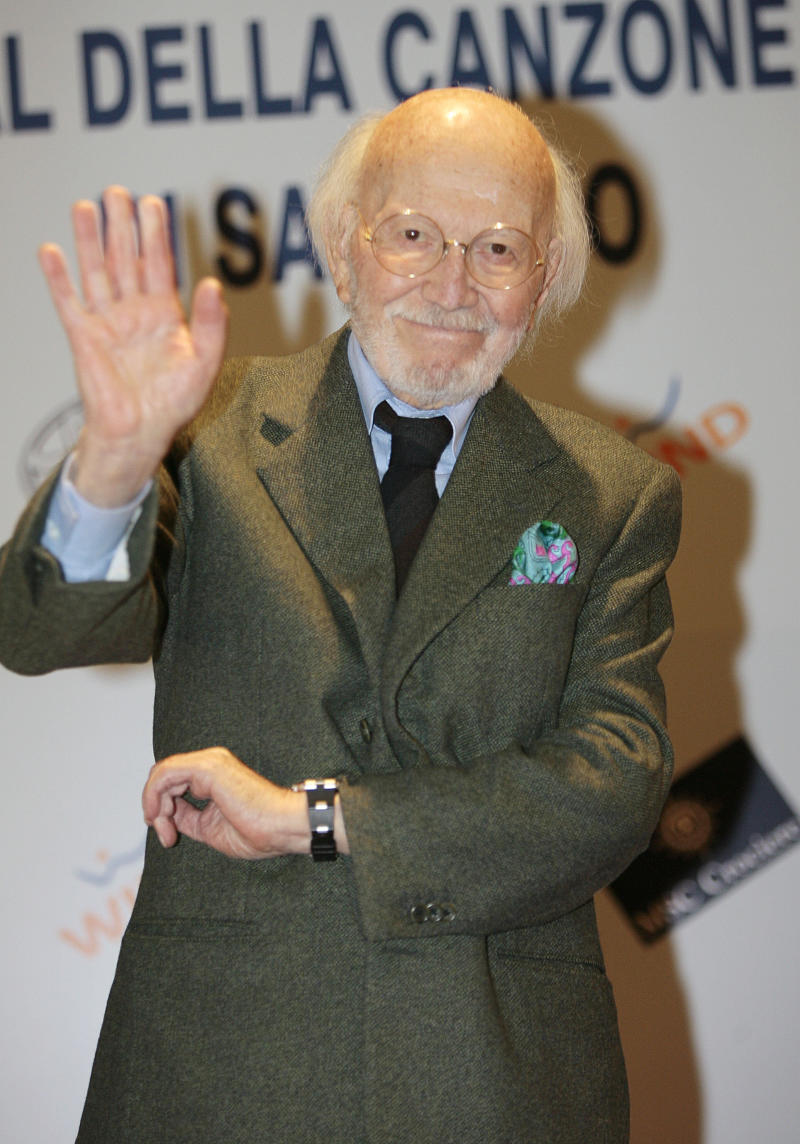 "FILE -- In this file photo taken at the Sanremo song festival on March 2, 2007, Italian composer Armando Trovajoli waves during a photo call. Trovajoli, who composed music for some 300 films and wrote a serenade to Rome popular with tourists, has died in Rome at age 95. Among Trovajoli's hits was ""Roma nun fa' la stupida stasera,"" a romantic melody played for visitors to Rome. He composed scores for Italian hit movies including ""A Special Day"" and ""Two Women,"" starring Sophia Loren, and the neorealism classic ""Riso Amaro."" A pianist, he played alongside such jazz greats as Miles Davis, Duke Ellington and Chet Baker. (AP Photo/Luca Bruno)"