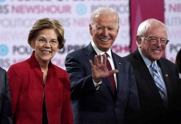 PHOTO: Democratic presidential candidates Sen. Elizabeth Warren, former Vice President Joe Biden and Sen. Bernie Sanders stand onstage before the start of the debate at Loyola Marymount University in Los Angeles, on Dec. 19, 2019. (Mike Blake/Reuters, File)