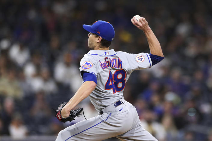 New York Mets starting pitcher Jacob deGrom delivers a pitch to a San Diego Padres batter during the sixth inning of a baseball game Saturday, June 5, 2021, in San Diego. (AP Photo/Derrick Tuskan)