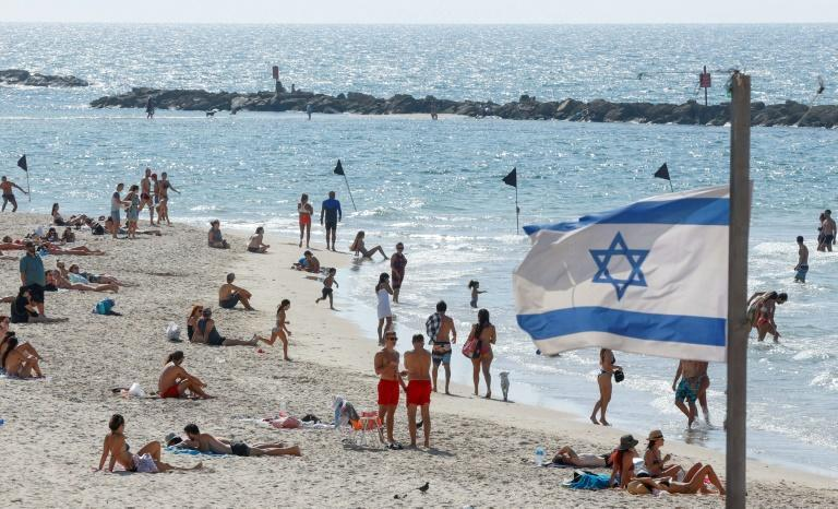 The beach in the Israeli coastal city of Tel Aviv reopened on Sunday as new infection numbers receded
