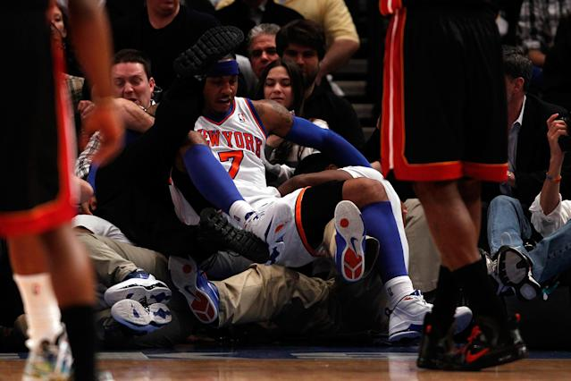 NEW YORK, NY - MAY 06: Carmelo Anthony #7 of the New York Knicks falls into a row of photographers in the first quarter against the New York Knicks in Game Four of the Eastern Conference Quarterfinals in the 2012 NBA Playoffs on May 6, 2012 at Madison Square Garden in New York City. NOTE TO USER: User expressly acknowledges and agrees that, by downloading and or using this photograph, User is consenting to the terms and conditions of the Getty Images License Agreement (Photo by Jeff Zelevansky/Getty Images)