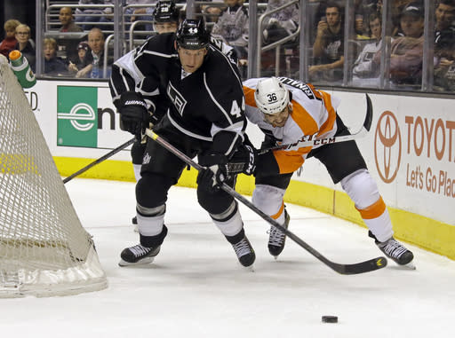 Los Angeles Kings defenseman Robyn Regehr (44) and Philadelphia Flyers center Zac Rinaldo (36) battle in the first period of an NHL hockey game in Los Angeles Saturday, Feb. 1, 2014. (AP Photo/Reed Saxon)