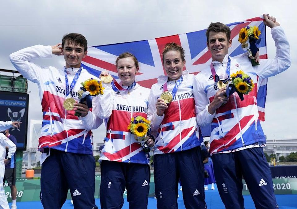 Alex Yee, Georgia Taylor-Brown, Jessica Learmonth and Jonny Brownlee cheer their victory (Danny Lawson / PA)