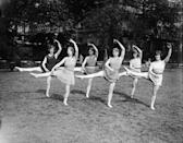 <p>While dance may not have been thought of as a workout, exactly, it was always a popular way to be active. This photo shows the Isalde and Alexis dancing group practicing outside on a sunny day in June back in 1929. <br></p>
