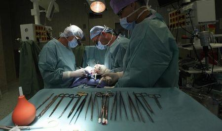 Professor Pirk, doctor Urban and suture nurse Vapenkova perform a heart surgery at the IKEM in Prague