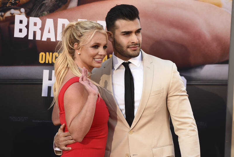 "Britney Spears and Sam Asghari arrive at the Los Angeles premiere of ""Once Upon a Time in Hollywood"" at the TCL Chinese Theatre on July 22, 2019. (Photo by Jordan Strauss/Invision/AP)"