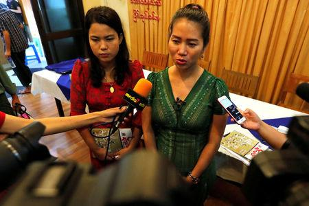 Pan Ei Mon and Chit Su Win  wives of jailed Reuters' journalists Wa Lone and Kyaw Soe Oo speaks to media after receiving an award in Yangon