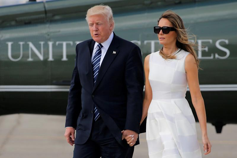 U.S. President Donald Trump and first lady Melania Trump hold hands as they arrive to board Air Force One for travel to Rome from Ben Gurion International Airport in Tel Aviv, Israel on May 23.  (Jonathan Ernst / Reuters)
