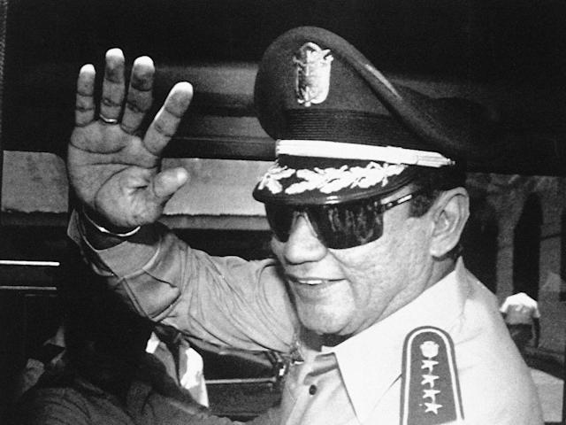 <p>Gen. Manuel Antonio Noriega waves to the media after a state council meeting at the presidential palace in Panama City, where the council announced the new president of the republic, Aug. 31, 1989 . (AP Photo/Matias Recart, File) </p>
