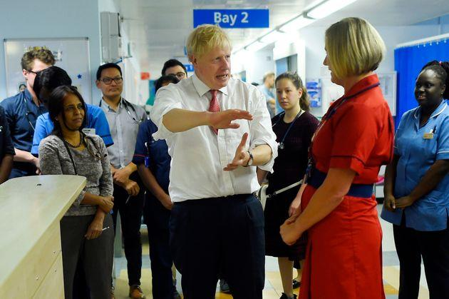 Johnson speaks to medical staff during his visit to Watford General Hospital