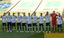 Argentina's starting players line up prior a qualifying soccer match against Brazil for the FIFA World Cup Qatar 2022 at Neo Quimica Arena stadium in Sao Paulo, Brazil, Sunday, Sept.5, 2021. (AP Photo/Andre Penner)