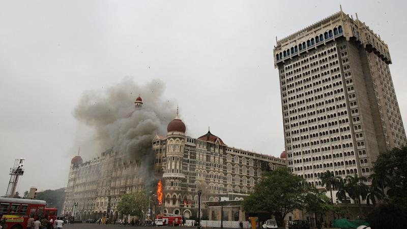 Smoke billows out of The Taj Mahal Hotel during the rescue operations.