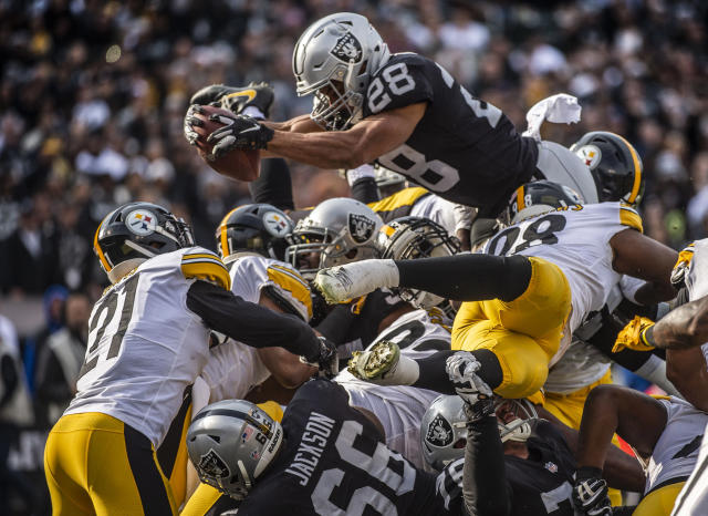 <p>Oakland Raiders running back Doug Martin (28) goes over the top for a touchdown against the Pittsburgh Steelers on Sunday, Dec. 9, 2018 at the Oakland-Alameda County Coliseum in Oakland, Calif. (Hector Amezcua/Sacramento Bee/TNS) </p>
