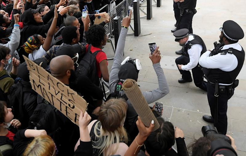 Some police officers spontaneously took the knee in front of protesters near Downing Street during a Black Lives Matter protest following the death of George Floyd. (Picture: REUTERS/Toby Melville)