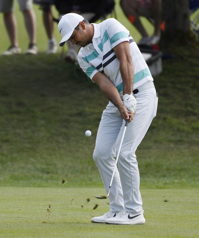 Jason Day hits his second shot on the 15th hole during the third round of the Travelers Championship golf tournament Saturday, June 22, 2019, in Cromwell, Conn. (AP Photo/Jessica Hill)